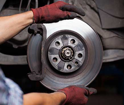 Auto Mechanic at G & G Automotive replacing brake pads